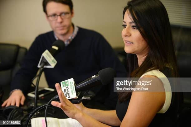 Radio host Lilian Mass talks to Hans Riemer President of the Montgomery County Council during a live radio show at Radio America WACA 1540AM in...