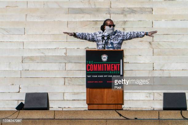 Radio host Mark Thompson, who served as MC of the event, holds his arms out while asking participants of the March on Washington to remember to keep...
