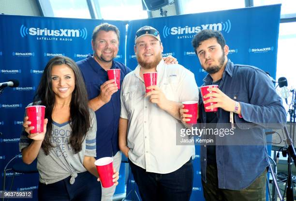 Radio host Mary Carlisle Callahan host Storme Warren country artist Luke Combs and Thomas Massad visit The Highway at SiriusXM Studios on May 30 2018...