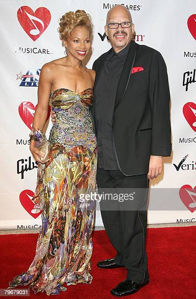 Radio host Tom Joyner and his wife Donna Richardson Joyner arrive at the 2008 MusiCares Person of the Year Dinner February 08 2008 at the Los Angeles...