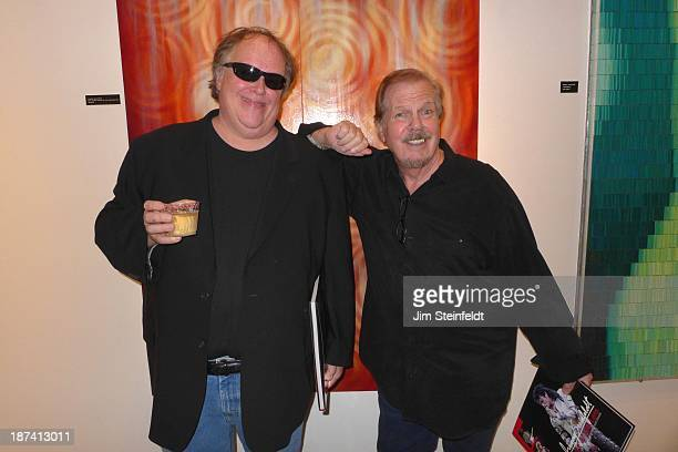 Radio host Tom Leykis and gossip columnist for the National Enquirer and host of National Enquirer TV Mike Walker pose for a portrait at the Mike...