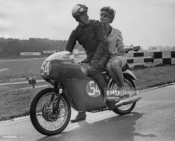 Radio Luxembourg disc jockey Jimmy Savile with Pat Quinlan of Sheen on a 250cc Honda twin at the Brands Hatch motor racing circuit in Kent 7th...