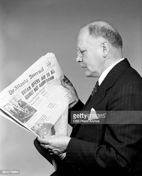 Radio news commentator and analyst HV Kaltenborn poses for a portrait holding a copy of the The Atlanta Journal from April 3 1939 The headline reads...