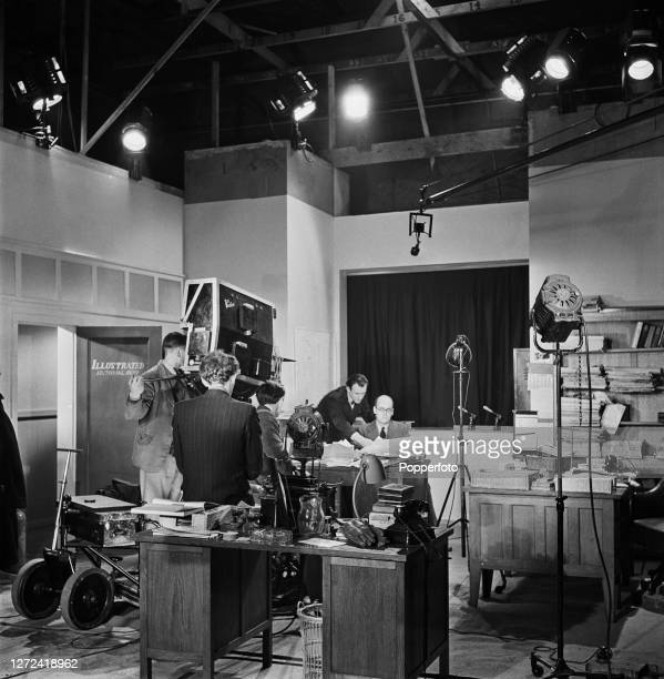 BBC radio newsreader Bruce Belfrage is filmed for a news broadcast from the offices of Illustrated Magazine in London during World War II in January...