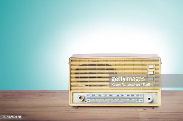radio on table against wall - global radio studios stock photos and pictures