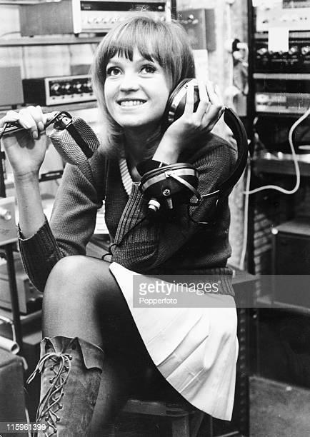 BBC radio One disc jockey Anne Nightingale on air in London on 7th December 1970