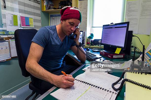 A radio operator in the communications room of an Antarctic base.