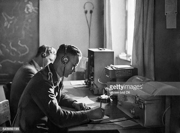 Radio operator with headphones Photographer Curt Ullmann Published by 'Sieben Tage' 02/1936Vintage property of ullstein bild