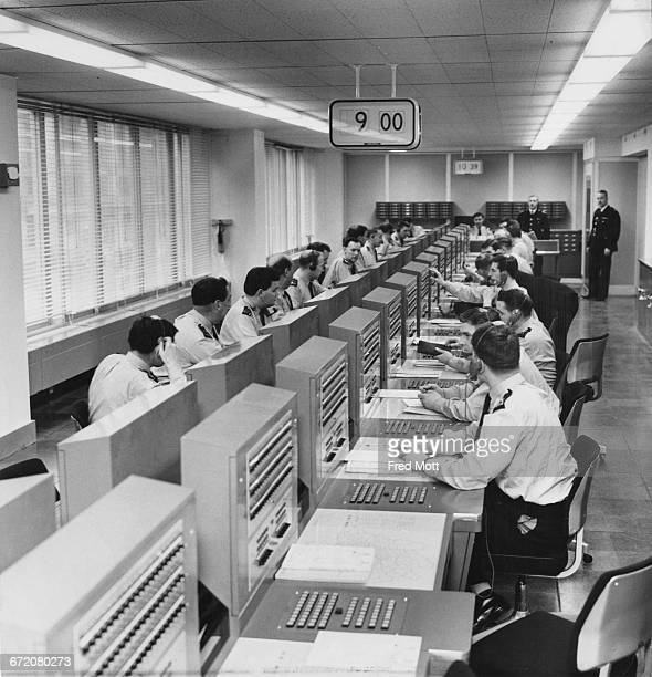Radio operators in the Information Room at the New Scotland Yard building on Broadway London 9th February 1967 shortly after the headquarters of the...