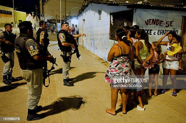 Radio Patrol Battalion second lieutenant Washington talks to residents during an operation at BeiraMar shantytown in Maceio northeastern Brazil on...