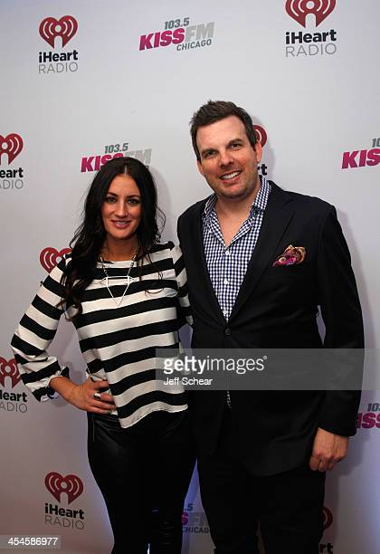 Radio personalities Angi Taylor and Brotha' Fred pose backstage at 1035 KISS FM's Jingle Ball 2013 presented by Jam Audio Collection at United Center...