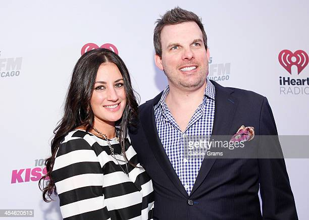 Radio personalities Angi Taylor and Brotha' Fred pose in the press room at 1035 KISS FM's Jingle Ball 2013 at United Center on December 9 2013 in...