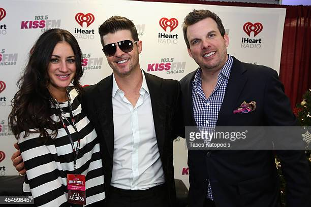Radio personalities Angi Taylor and Brotha' Fred pose with Robin Thicke backstage at 1035 KISS FM's Jingle Ball 2013 presented by Jam Audio...