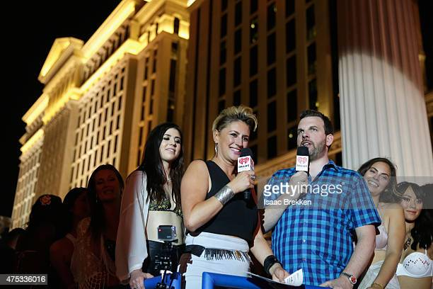 Radio personalities Angi Taylor and Brotha Fred speak onstage during The iHeartRadio Summer Pool Party at Caesars Palace on May 30 2015 in Las Vegas...