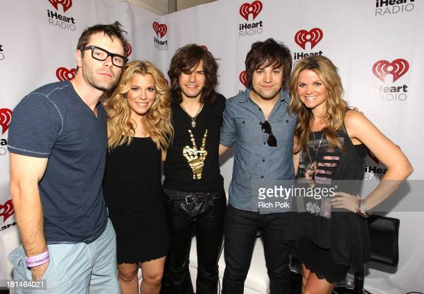 Radio personalities Bobby Bones and Amy Brown pose with Kimberly Perry Reid Perry and Neil Perry of The Band Perry during the iHeartRadio Music...