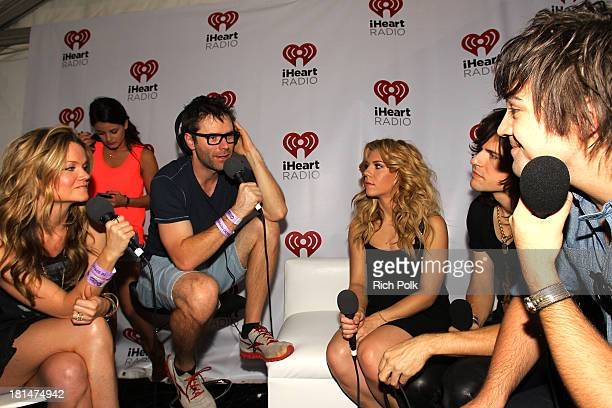 Radio personalities Bobby Bones and Amy Brown speak with Kimberly Perry Reid Perry and Neil Perry of The Band Perry attend the iHeartRadio Music...