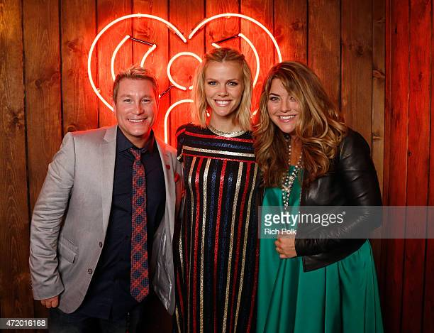 Radio personalities Boxer and Anne Hudson pose with Model Brooklyn Decker backstage during the 2015 iHeartRadio Country Festival at The Frank Erwin...