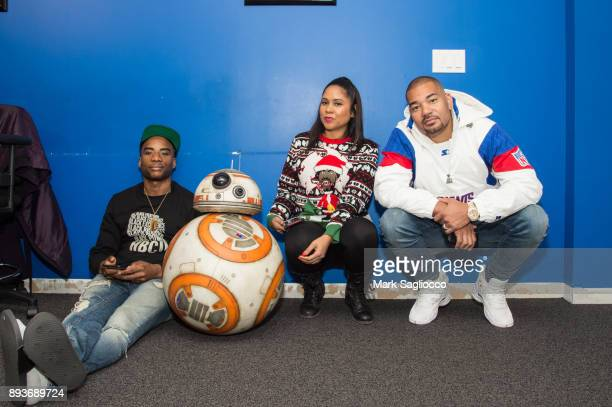 Radio Personalities Charlamagne Tha God Angela Yee and pose with Star War's BB8 at iHeart Radio on December 15 2017 in New York City