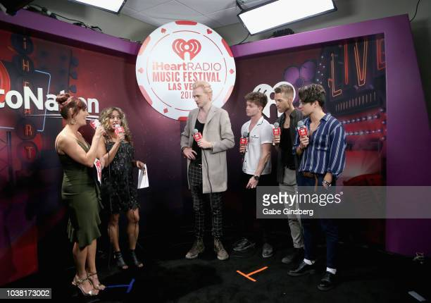 Radio personalities Danielle Monaro and Medha Gandhi speak with Tristan Evans Connor Ball James McVey and Bradley Simpson of The Vamps during the...