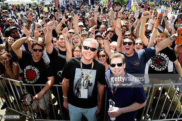 Radio personalities Gene 'Bean' Baxter and Ralph Garman pose with fans at KROQ Weenie Roast 2016 at Irvine Meadows Amphitheatre on May 14 2016 in...