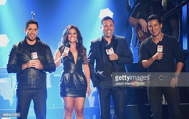 Radio personalities John Musa Jenny Castillo Professional Boxer Oscar De La Hoya and iHeartRadio Personality Mario Lopez onstage during the...