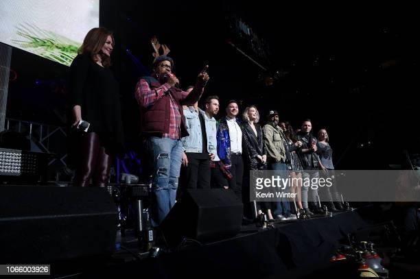 Radio personalities Kellie Rasberry Big Al Mack Cruz JSi PartTime Justin Raven Pooh Jenna Owens Billy the Kidd and Priscilla speak onstage during...