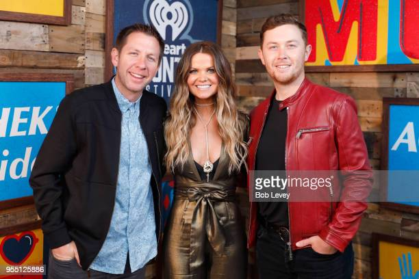 Radio personalities Lunchbox and Amy of 'The Bobby Bones Show' and Scotty McCreery pose backstage at the 2018 iHeartCountry Festival By ATT at The...
