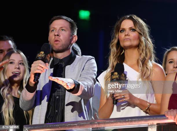 Radio personalities Lunchbox and Amy of 'The Bobby Bones Show' speak onstage during the 2017 iHeartCountry Festival A Music Experience by ATT at The...