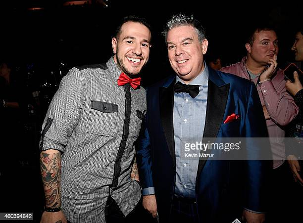Radio personalities Mo' Bounce and Elvis Duran pose backstage at iHeartRadio Jingle Ball 2014 hosted by Z100 New York and presented by Goldfish Puffs...