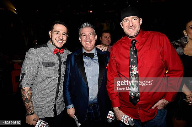 Radio personalities Mo' Bounce Elvis Duran and JJ Kincaid pose backstage at iHeartRadio Jingle Ball 2014 hosted by Z100 New York and presented by...