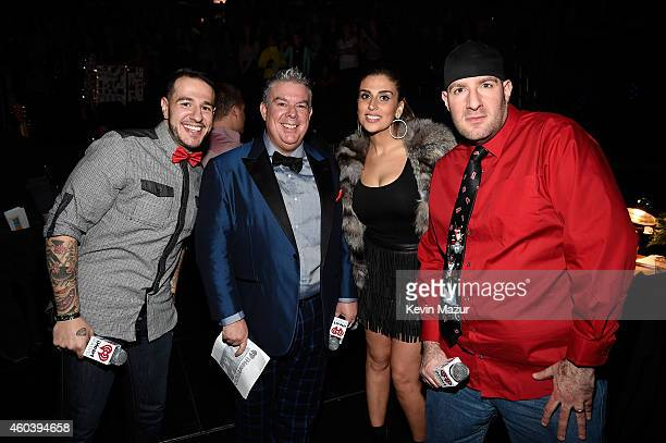 Radio personalities Mo' Bounce Elvis Duran Shelley Rome and JJ Kincaid pose backstage at iHeartRadio Jingle Ball 2014 hosted by Z100 New York and...
