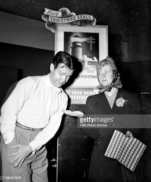 Radio personalities promote the purchase of Christmas Seals Hollywood CA Arthur Lake and Penny Singleton stars of the comedy program Blondie October...
