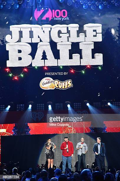 Radio personalities Shelley Rome JJ Kincaid Mo' Bounce and Elvis Duran speak onstage during iHeartRadio Jingle Ball 2014 hosted by Z100 New York and...