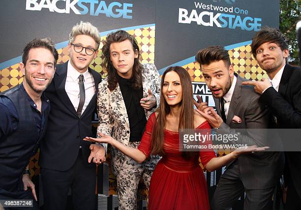 Radio personalities Ty Bentli and Kerri Kasem pose with recording artists Niall Horan Harry Styles Liam Payne and Louis Tomlinson of music group One...