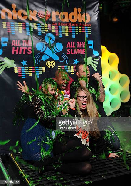 Radio personalities Wendy Wild Maxwell Mo' Bounce and Erica America get slimed at iHeartRadio's Nick Radio launch party on October 24 2013 in New...