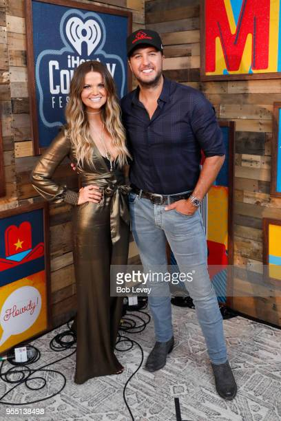 Radio personality Amy of 'The Bobby Bones Show' and Luke Bryan pose backstage at the 2018 iHeartCountry Festival By AT&T at The Frank Erwin Center on...