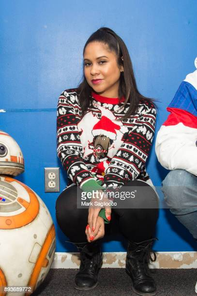 Radio Personality Angela Yee pose with Star War's BB8 at iHeart Radio on December 15 2017 in New York City
