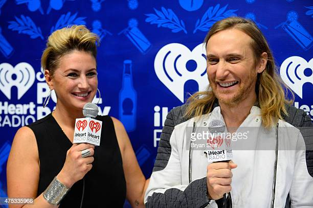 Radio personality Angi Taylor and DJ David Guetta attend The iHeartRadio Summer Pool Party at Caesars Palace on May 30 2015 in Las Vegas Nevada