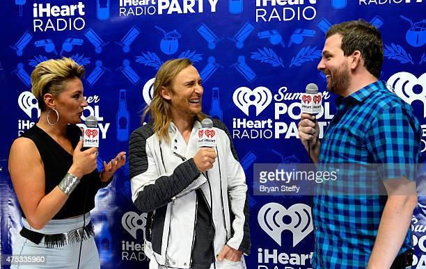 Radio personality Angi Taylor DJ David Guetta and radio personality Brotha Fred attend The iHeartRadio Summer Pool Party at Caesars Palace on May 30...