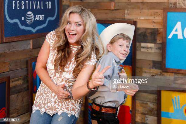 Radio personality Anne Hudson and Mason Ramsey pose backstage at the 2018 iHeartCountry Festival By ATT at The Frank Erwin Center on May 5 2018 in...