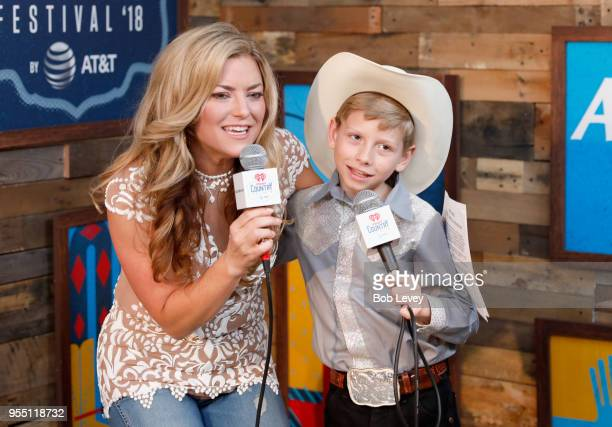 Radio personality Anne Hudson and Mason Ramsey speak backstage at the 2018 iHeartCountry Festival By ATT at The Frank Erwin Center on May 5 2018 in...
