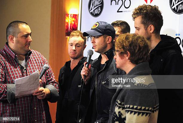 Radio personality Big D and recording artists Eddie Fisher Ryan Tedder Zach Filkins Drew Brown and Brent Kutzle of music group OneRepublic attend...