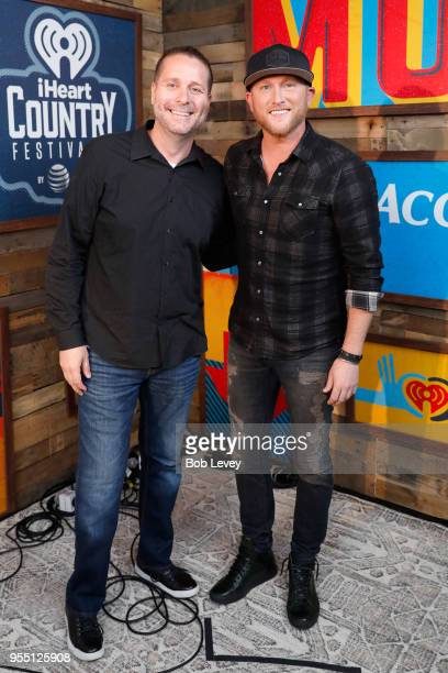 Radio personality Billy Greenwood and Cole Swindell pose backstage at the 2018 iHeartCountry Festival By ATT at The Frank Erwin Center on May 5 2018...