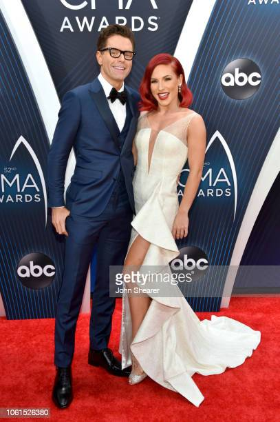 Radio personality Bobby Bones and Ballroom dancer Sharna Burgess attend the 52nd annual CMA Awards at the Bridgestone Arena on November 14 2018 in...