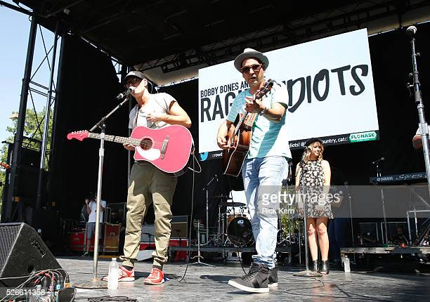 Radio personality Bobby Bones and Producer Eddie of Bobby Bones and The Raging Idiots perform live during the 2016 Daytime Village at the...