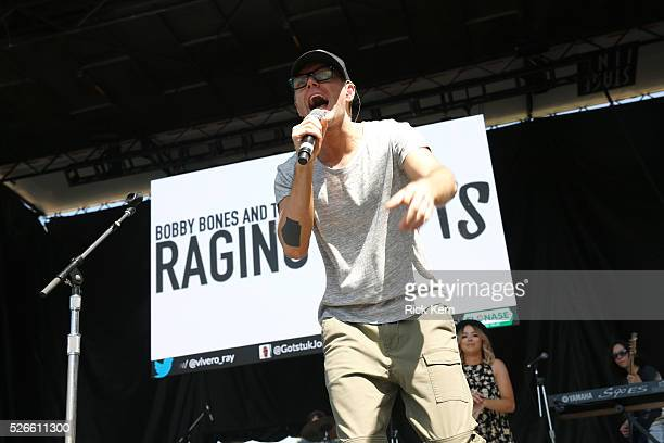 Radio personality Bobby Bones of Bobby Bones and The Raging Idiots performs live during the 2016 Daytime Village at the iHeartCountry Festival at The...