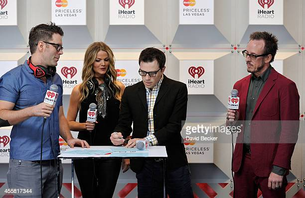 Radio personality Bobby Bones radio personality Amy Moffett and recording artists Rivers Cuomo and Scott Shriner of the music group Weezer attend the...