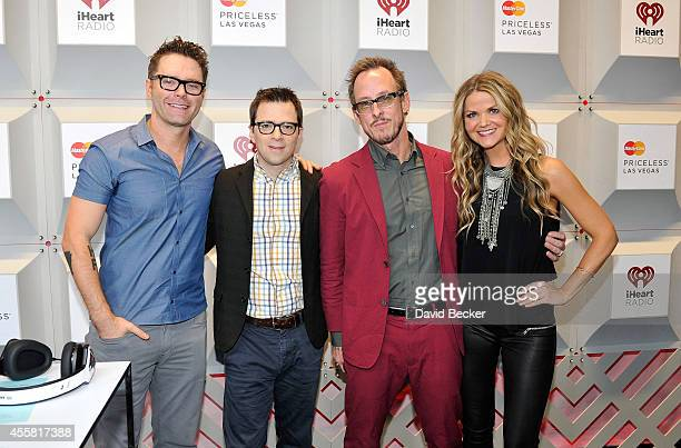 Radio personality Bobby Bones recording artists Rivers Cuomo and Scott Shriner of the music group Weezer and radio personality Amy Moffett attend the...