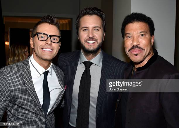 Radio Personality Bobby Bones singersongwriter Luke Bryan and singersongwriter Lionel Richie take photos togethere at the 2017 CMT Artists Of The...