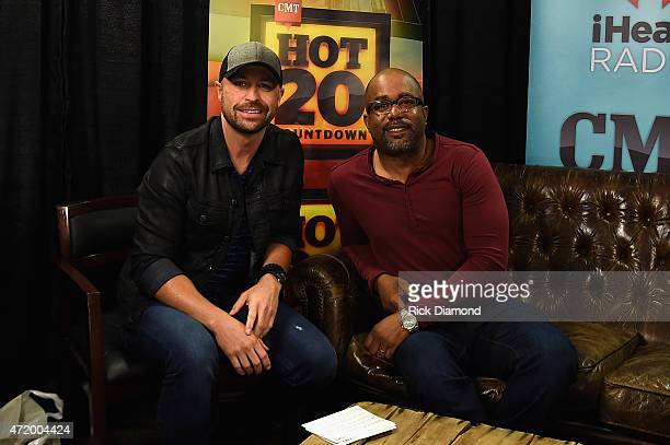 Radio personality Cody Alan and recording artist Darius Rucker pose backstage during the 2015 iHeartRadio Country Festival at The Frank Erwin Center...